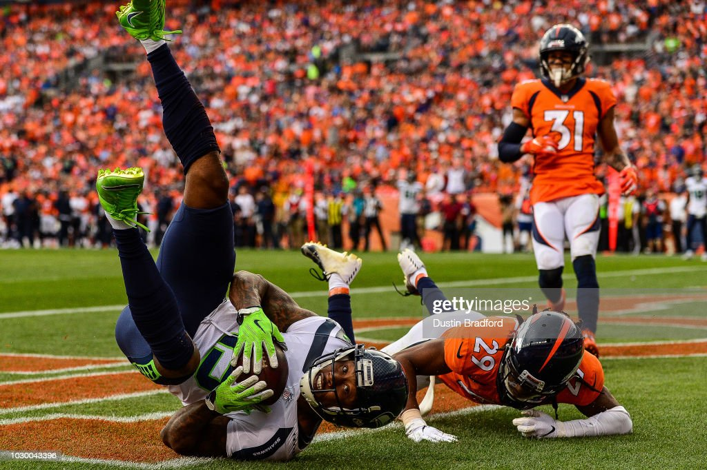 Wide receiver Brandon Marshall #15 of the Seattle Seahawks catches a touchdown pass under coverage by defensive back Bradley Roby #29 of the Denver Broncos in the third quarter of a game at Broncos Stadium at Mile High on September 9, 2018 in Denver, Colorado.