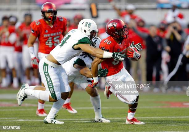UNLV wide receiver Brandon Presley breaks a tackle during a game against Hawaii on November 04 at Sam Boyd Stadium in Las Vegas Nevada The UNLV...