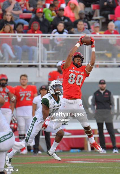 Wide receiver Brandon Presley of the UNLV Rebels catches a pass against defensive back Rojesterman Farris II of the Hawaii Warriors during their game...