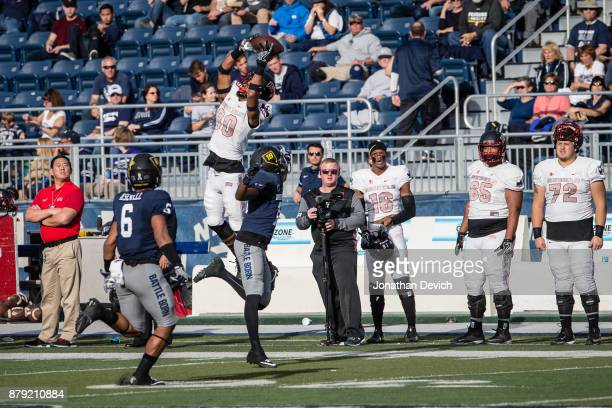 Wide receiver Brandon Presley of the UNLV Rebels jumps to catch the ball over top of defensive back Elijah Moody of the Nevada Wolf Pack during a...