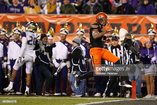 Wide receiver Brandon Sheperd of the Oklahoma State Cowboys runs into the end zone to score a 47 yard touchdown reception against the Washington...
