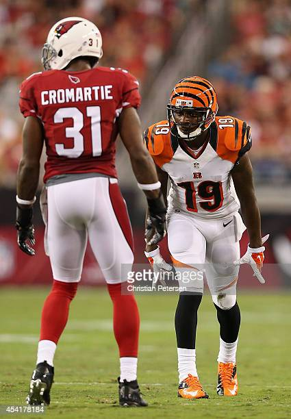 Wide receiver Brandon Tate of the Cincinnati Bengals lines up against cornerback Antonio Cromartie of the Arizona Cardinals during the preseason NFL...