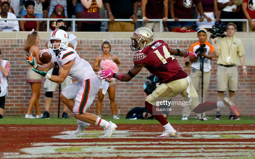 Wide receiver Braxton Berrios #8 of the Miami Hurricanes catches a pass for a touchdown over defensive back Kyle Meyers #14 of the Florida State Seminoles during the second half of an NCAA football game at Doak S. Campbell Stadium on October 7, 2017 in Tallahassee, Florida.
