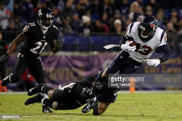 Wide Receiver Braxton Miller of the Houston Texans is tackled after a catch in the third quarter against the Baltimore Ravens at M&T Bank Stadium on...