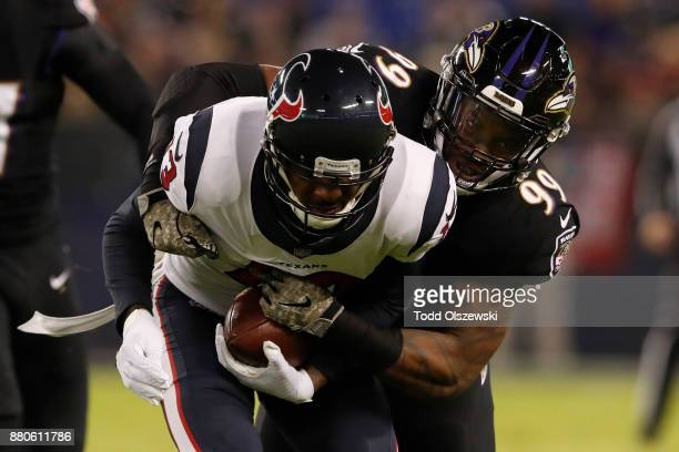 Wide Receiver Braxton Miller of the Houston Texans is tackled by outside linebacker Matt Judon of the Baltimore Ravens in the first quarter at M&T...