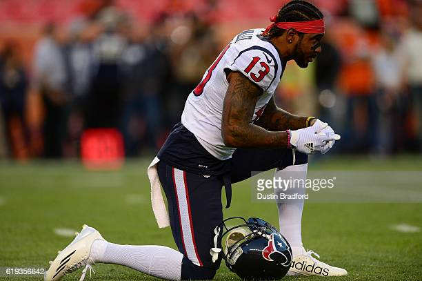 Wide receiver Braxton Miller of the Houston Texans stretches as he warms up before a game against the Denver Broncos at Sports Authority Field at...