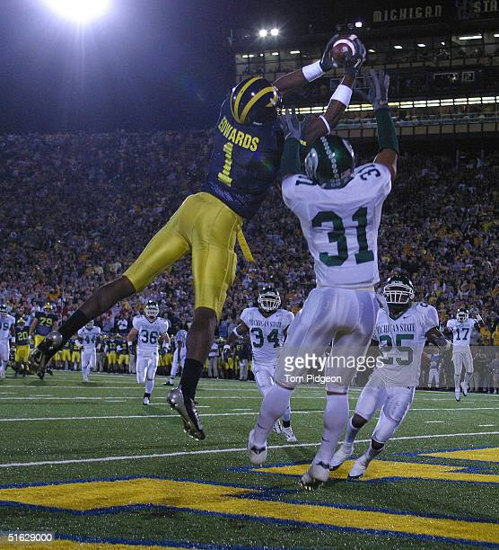 Wide receiver Braylon Edwards of Michigan catches a touchdown pass defended by Jaren Hayes of Michigan State at Michigan Stadium on October 30 2004...