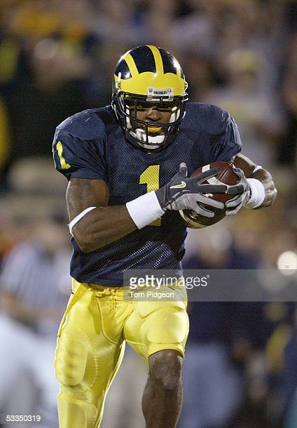 Wide receiver Braylon Edwards of the Michigan Wolverines runs upfield against the Michigan State Spartans during the game on October 30 2004 at...