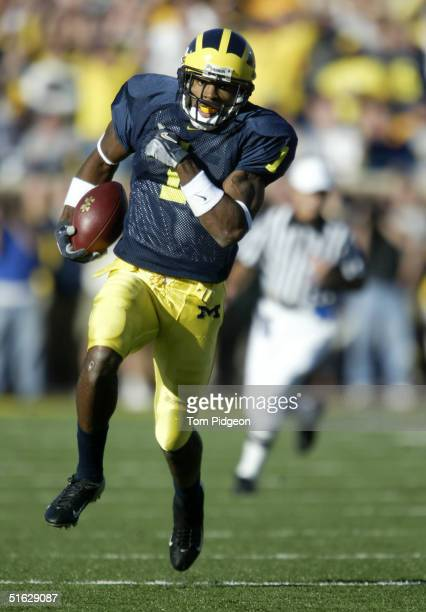 Wide Receiver Braylon Edwards of the Michigan Wolverines rushes after a reverse play against the Michigan State Spartans at Michigan Stadium on...