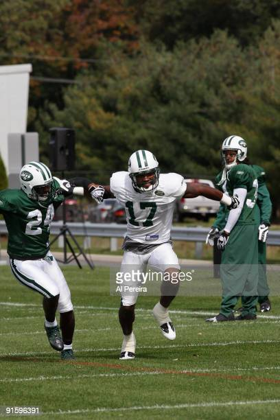 Wide Receiver Braylon Edwards of the New York Jets battles Cornerback Darrelle Revis in his first practice with his new team at the Atlantic Health...
