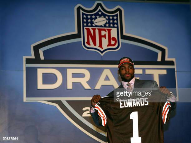 Wide receiver Braylon Edwards poses with his jersey after being drafted third overall by the Cleveland Browns during the 70th NFL Draft on April 23...