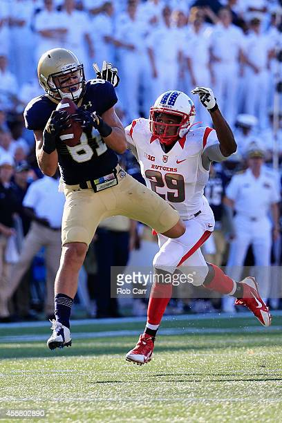 Wide receiver Brendan Dudeck of the Navy Midshipmen catches a pass in front of defensive back Davon Jacobs of the Rutgers Scarlet Knights during the...