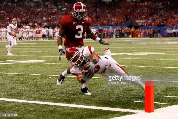 Wide receiver Brent Casteel of the Utah Utes scores a six-yard touchdwon as he dives into the endzone by Kareem Jackson of the Alabama Crimson Tide...