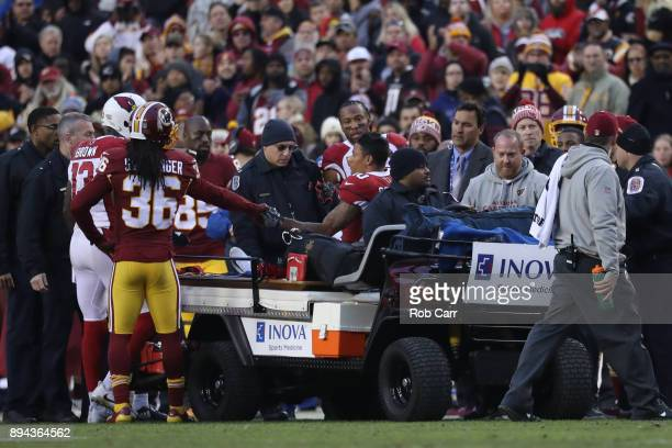 Wide receiver Brittan Golden of the Arizona Cardinals is carted off the field in the fourth quarter against the Washington Redskins at FedEx Field on...