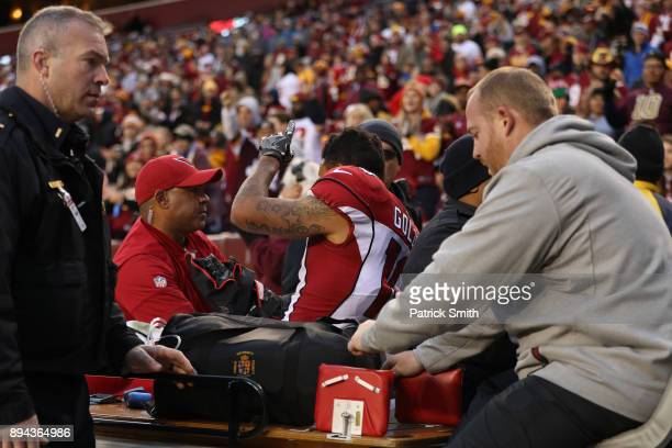 Wide Receiver Brittan Golden of the Arizona Cardinals is carted off the field in the fourth quarter against the Washington Redskinsat FedEx Field on...