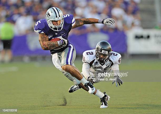 Wide receiver Brodrick Smith of the Kansas State Wildcats breaks up field for a 15yard gain past defensive back Howard Scarborough of the Missouri...