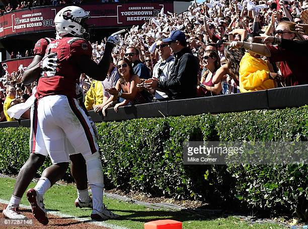 Wide receiver Bryan Edwards of the South Carolina Gamecocks points at fans following a touchdown reception against the Massachusetts Minutemen at...