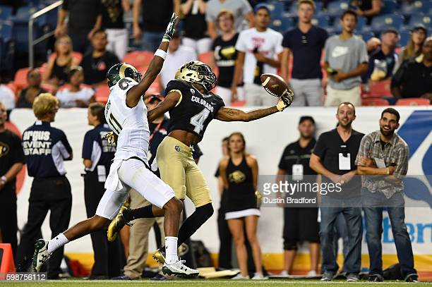 Wide receiver Bryce Bobo of the Colorado Buffaloes comes up with a large gain on a onehanded catch under coverage by defensive back Jordon Vaden of...