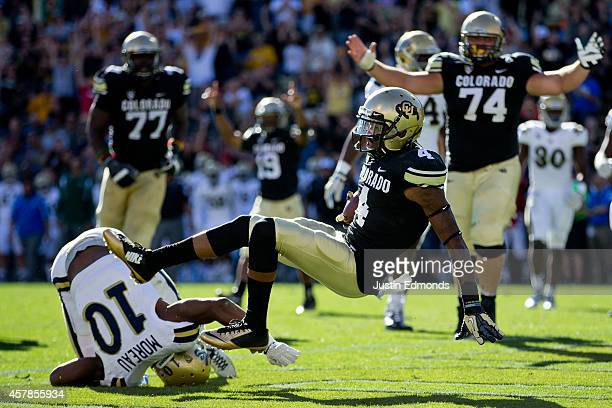 Wide receiver Bryce Bobo of the Colorado Buffaloes falls into the end zone after making a catch and beating defensive back Fabian Moreau of the UCLA...