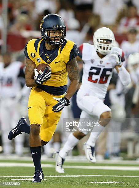 Wide receiver Bryce Treggs of the California Golden Bears runs with the football en route to scoring a 80 yard touchdown reception past safety...