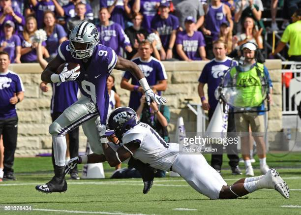 Wide receiver Byron Pringle of the Kansas State Wildcats can't brake away from defensive back Jeff Gladney of the TCU Horned Frogs during the first...