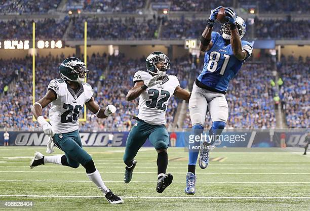 Wide receiver Calvin Johnson of the Detroit Lions catches a second quarter touchdown in front of Walter Thurmond and cornerback Eric Rowe of the...
