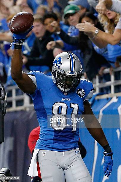 Wide receiver Calvin Johnson of the Detroit Lions celebrates after catching a six yard touchdown reception against the Chicago Bears during the...
