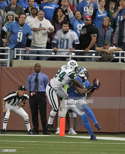 Wide Receiver Calvin Johnson of the Detroit Lions fights for a ball in the End Zone with Cornerback Darrelle Revis of the New York Jets when the...