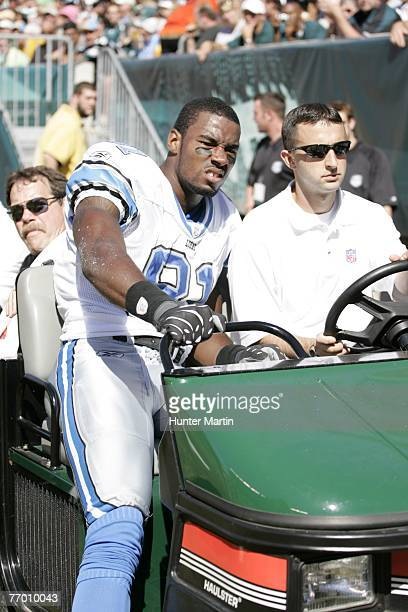 Wide receiver Calvin Johnson of the Detroit Lions is carted off the field with an injury during a game against the Philadelphia Eagles on September...