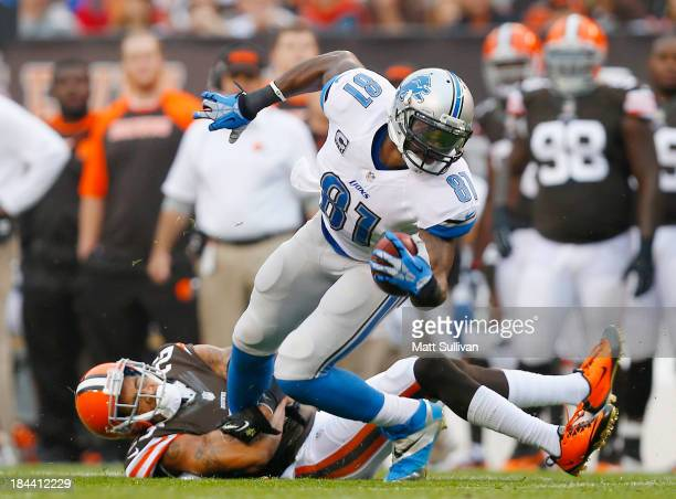 Wide receiver Calvin Johnson of the Detroit Lions is hit by defensive back Joe Haden of the Cleveland Browns at FirstEnergy Stadium on October 13...