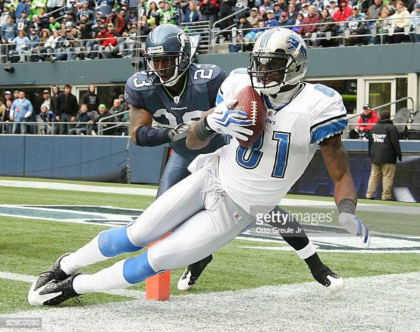 Wide receiver Calvin Johnson of the Detroit Lions makes a catch at the one-yard line against Marcus Trufant of the Seattle Seahawks on November 8,...
