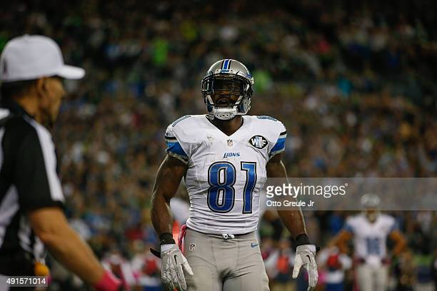 Wide receiver Calvin Johnson of the Detroit Lions reacts after fumbling the ball near the goal line against the Seattle Seahawks at CenturyLink Field...