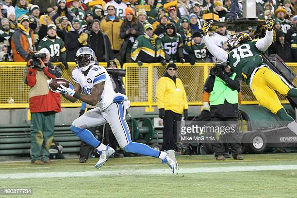 Wide receiver Calvin Johnson of the Detroit Lions receives a four yard pass past cornerback Tramon Williams of the Green Bay Packers for a touchdown...