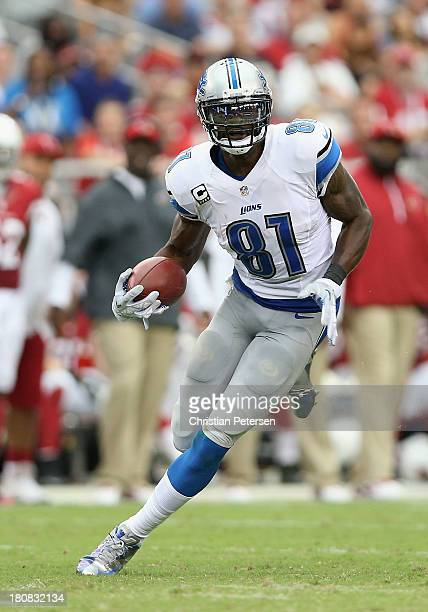 Wide receiver Calvin Johnson of the Detroit Lions runs with the football after a reception against the Arizona Cardinals during the NFL game at the...