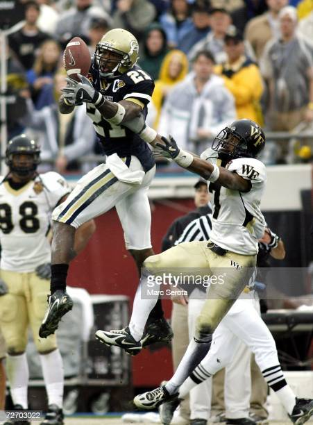 Wide Receiver Calvin Johnson of the Georgia Tech Yellow Jackets cannot make the catch as cornerback Riley Swanson of the Wake Forest Demon Deacons...