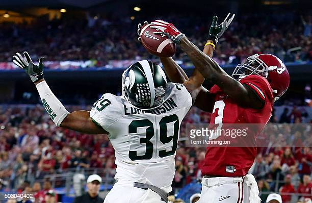 Wide receiver Calvin Ridley of the Alabama Crimson Tide catches a sixyard touchdown pass against cornerback Jermaine Edmondson of the Michigan State...