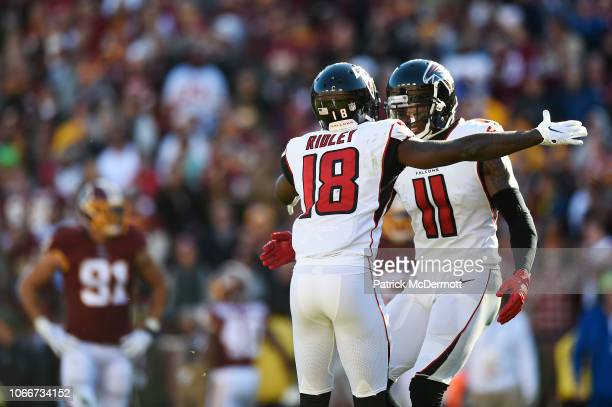 Wide receiver Calvin Ridley of the Atlanta Falcons celebrates with teammate wide receiver Julio Jones after scoring a touchdown in the second quarter...
