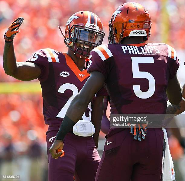 Wide receiver Cam Phillips of the Virginia Tech Hokies celebrates his punt block with defensive back Greg Stroman in the first half against the East...