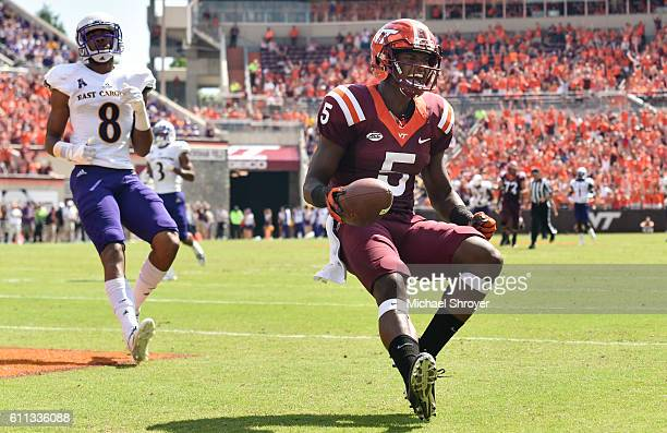 Wide receiver Cam Phillips of the Virginia Tech Hokies reacts following his touchdown reception against the East Carolina Pirates in the first half...