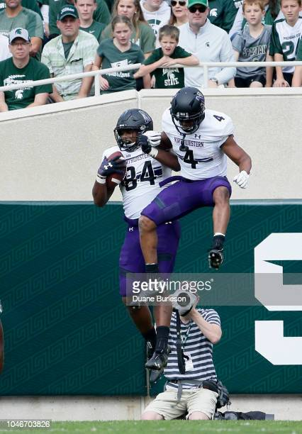 Wide receiver Cameron Green of the Northwestern Wildcats celebrates his touchdown against the Michigan State Spartans with wide receiver Solomon...