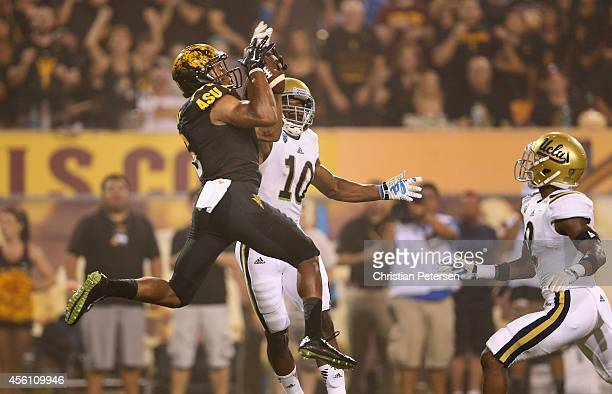Wide receiver Cameron Smith of the Arizona State Sun Devils catches a 29 yard touchdown reception over defensive back Fabian Moreau of the UCLA...