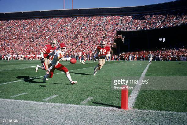 Wide receiver Carlos Carson of the Kansas City Chiefs can't make the reception while covered by cornerback Dwight Hicks of the San Francisco 49ers...