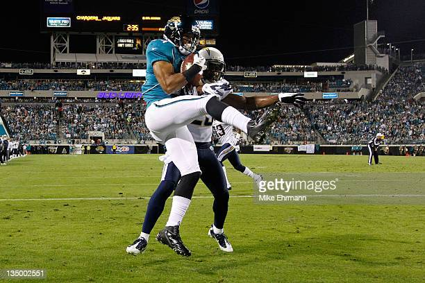 Wide receiver Cecil Shorts of the Jacksonville Jaguars catches a touchdown in front of cornerback Quentin Jammer of the San Diego Chargers in the...