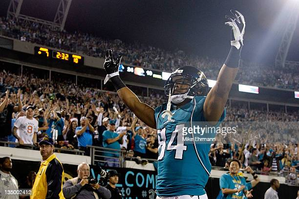 Wide receiver Cecil Shorts of the Jacksonville Jaguars celebrates scoring a touchdown against the San Diego Chargers in the second quarter at...
