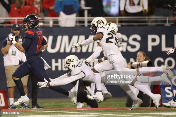Wide receiver Cedric Peterson of the Arizona Wildcats runs with the football en route to scoring a 57 yard touchdown reception against the Colorado...
