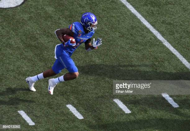 Wide receiver Cedrick Wilson of the Boise State Broncos runs for a 10yard gain against the Oregon Ducks in the first half of the Las Vegas Bowl at...