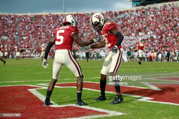 Wide receiver CeeDee Lamb and wide receiver Marquise Brown of the Oklahoma Sooners celebrate a touchdown against the Baylor Bears at Gaylord Family...