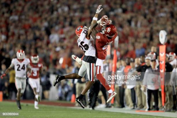 Wide receiver CeeDee Lamb of the Oklahoma Sooners makes a leaping 36yard catch against defensive back Tyrique McGhee of the Georgia Bulldogs in the...