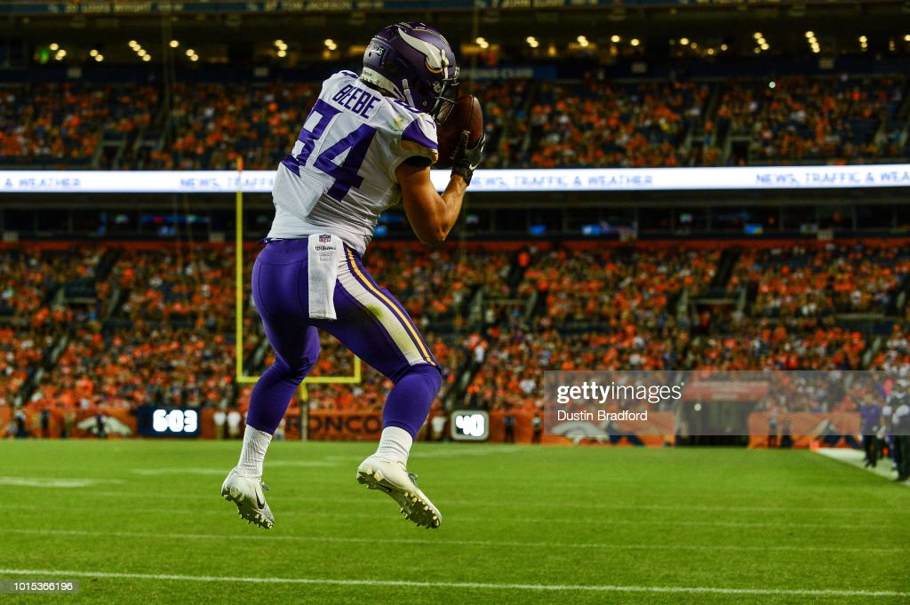 Wide receiver Chad Beebe #84 of the Minnesota Vikings catches a pass for a fourth quarter touchdown against the Denver Broncos during an NFL preseason game at Broncos Stadium at Mile High on August 11, 2018 in Denver, Colorado.