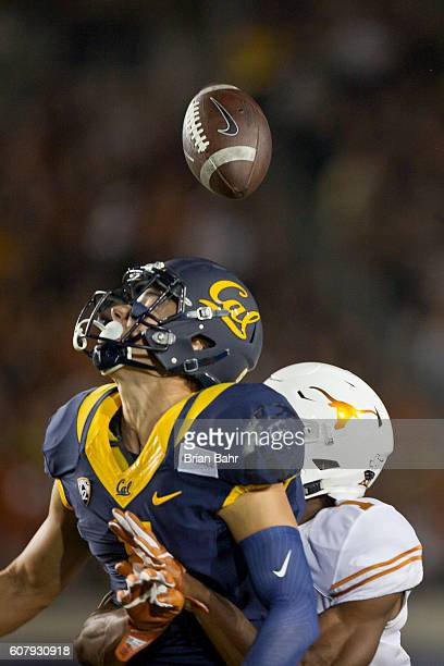Wide receiver Chad Hansen of the California Golden Bears can't pull in a pass under tight defense by John Burt of the Texas Longhorns in the first...